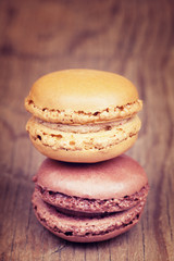 Two macaroons on retro vintage wooden background