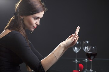Woman with engagement ring in restaurant