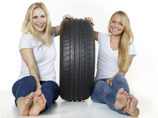 Two girls with tire