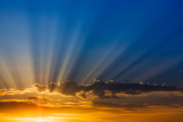 Rays of light over blue sky