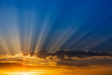 Rays of light over blue sky