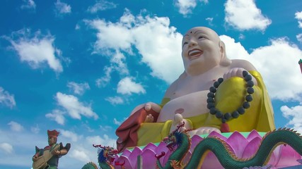 HD Time Lapse Colorful Buddha image CU pan right