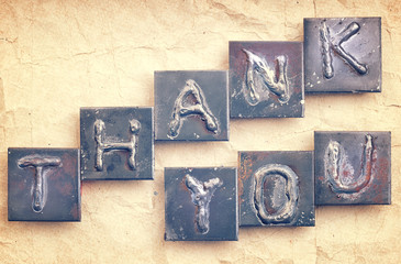 """The phase """"THANK YOU"""" made from metal letters on an old vintage"""