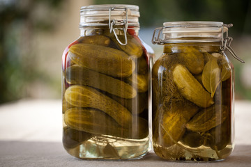 Glass jars of homemade canned cucumbers