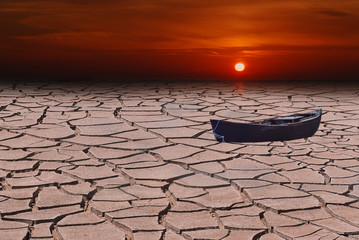 Old fishing boat in the desert in case of global warming