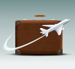 white plane flies around the brown suitcase