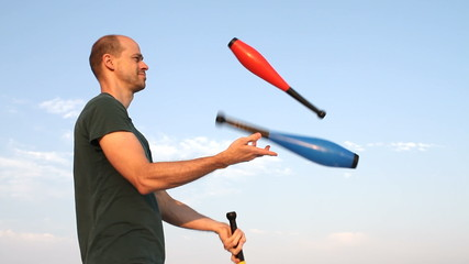 Man Juggling Clubs