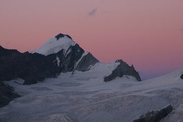 Pink Sky And High Mountain