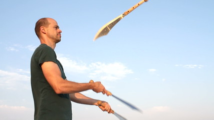 Man Juggling Knives