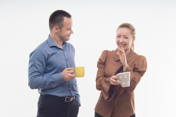 Stylish workmates laughing while having coffee together