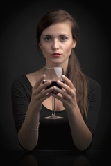 Glamour portrait of woman with glass of wine