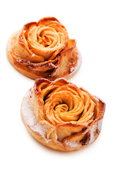 Cake in the shape of a rose isolated on white