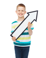 smiling little boy with blank arrow pointing up
