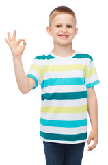 little boy in casual clothes showing OK gesture