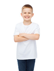 little boy in white t-shirt with arms crossed