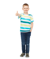 little boy in casual clothes showing thumbs up