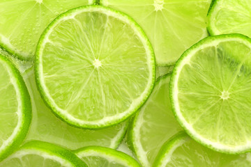 lime slices in sparkling water