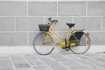 Yellow bike against the wall