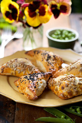 Puff pastry filled with green peas and cheese