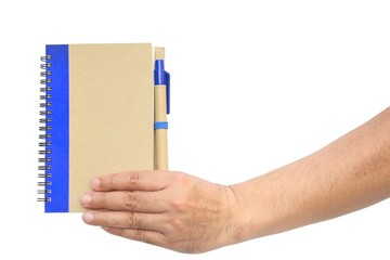 Hand hold a brown notebook
