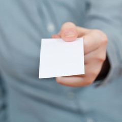 blank business card in female hand