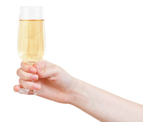 hand holds wineglass with sparkling wine