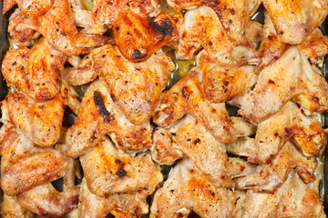 top view of many roasted spicy chicken wings