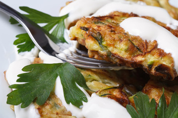 Zucchini pancakes with sour cream and parsley macro
