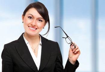 Businesswoman holding her glasses
