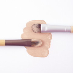 Foundation with brushes on white background
