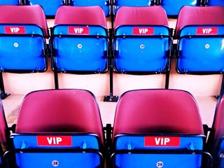 blue vip-chairs on sport stadium