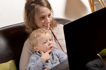 young mother and her child looking at a laptop