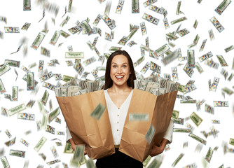 excited happy woman under dollar's rain