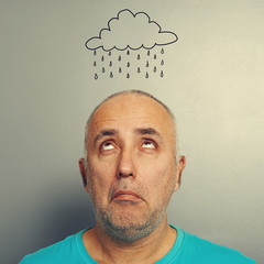 senior man with drawing storm cloud