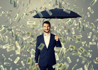 smiley and glad man under money rain