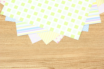 Paper for scrapbooking, on wooden table