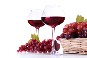 Wineglasses with red wine and  grape in wicker basket isolated