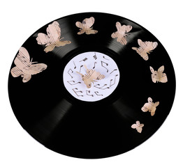Old vinyl record with paper butterflies, isolated on white