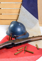 french helmet of the First World War with a gun on a red white b