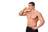 muscular sports man drinking juice isolated on white background