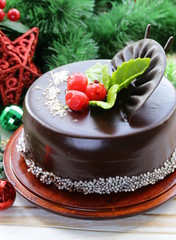 delicious Christmas chocolate cake on festive table