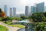 Fototapeta City park with modern buildings in Downtown of Kuala Lumpur