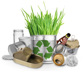 Can with growing grass and trash for recycle