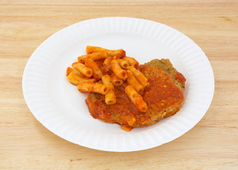 Breaded chicken with pasta in tomato sauce