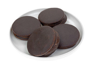 Plate of four chocolate snack cakes