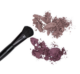 Crushed eyeshadow brown and plum shades with makeup brush