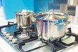 Leinwanddruck Bild - Stove with saucepan on the white modern kitchen
