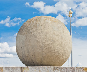Stone (concrete) sphere against a sky background