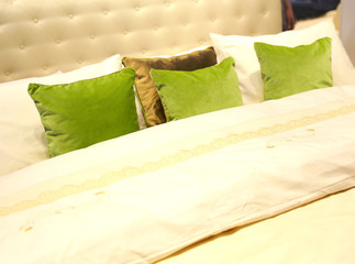 Colorful pillows on hotel bed