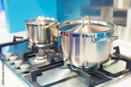 Leinwanddruck Bild Stove with saucepan on the white modern kitchen